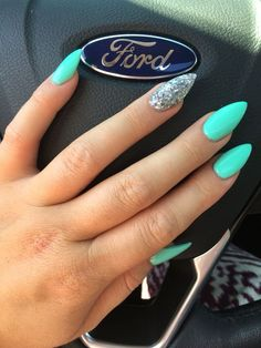Combination of stiletto and almond  nails. Turquoise blue with chunky silver accent nail.  Summer nails. Tiffney blue. Accent nail. Silver sparkle. Nail shape.