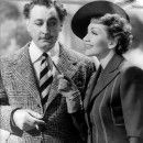 Claudette Colbert and fairy godfather John Barrymore in Midnight.