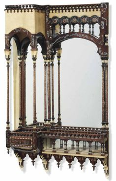 CARLO BUGATTI (1856-1940), ARCHITECTURAL WALL MIRROR, early 20th century, walnut, vellum, embossed copper, bone and pewter inlay, 57 in. (144.8 cm.) high; 35 in. (88.8 cm.) wide; 12 in. (30.5 cm.) deep      SOLD $19,425 Christie's London, May 1, 2013