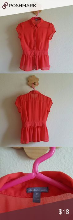 Charlotte Russe coral pink button up peplum blouse Beautiful coral pink top! Somewhat sheer short sleeved blouse with light wear; no holes, no tears. Tiny threads have popped up here and there, but no holes. I am a 34B typically fit for size S, so you can see in the last picture that it is a tight fit at the buttons around the waist for me! Material is see through. Cute paired with a fun cardigan! Charlotte Russe Tops Blouses