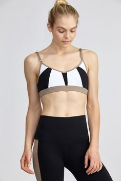 ea44f96619306 Women s Colorblock Racerback Sports Bra. This colorblocked bra by Alo  provides coverage with thin