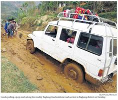 Traveling in remote areas of Nepal sometimes requires pulling your vehicles off the muddy road!