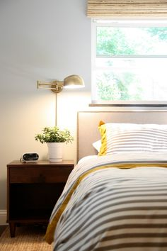 The style of lamp adds a retro touch to the room while the solid wood side table keeps everything grounded