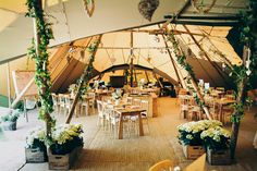 Tipi Decor - Jenny Packham Eden for a Tipi Wedding With All White Flowers and Images by David Jenkins