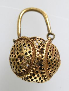 "Gold ""Basket"" Earring Date: 6th century Geography: Made in, Northern France Culture: Byzantine Medium: Gold Dimensions: Overall: 1 x 9/16 in. (2.5 x 1.5 cm) Classification: Metalwork-Gold Credit Line: Gift of J. Pierpont Morgan, 1917"