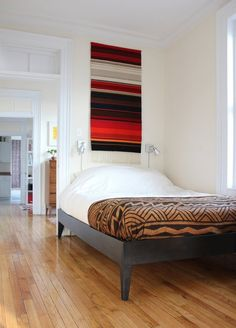 Rugs on a wall. We also love this bed spread that looks very much like West African mud cloth. Alana's Brooklyn Railroad House Tour | Apartment Therapy