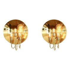 Pair of large dish sconces - $2600.