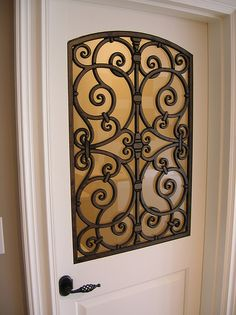 Faux Wrought Iron Decorative Door Insert. by tvonschimo, via Flickr