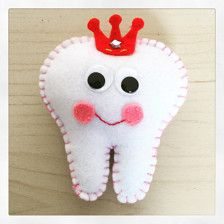 Handmade tooth fairy pillows with a pocket on the back to fit your childs tooth/money. You can choose your thread colour. Smoke and pet free home. Made from felt with googley eyes. Tooth is approx 3.5inch x 4inch. Initial can be sewn on back, princess felt crown with star gems.  Please feel free to message me about wholesale orders  Please note: this is not a toy