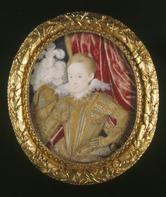 Henry Frederick Prince of Wales (1594-1612) shown here in his thirteenth year wearing a suit of armour of French make - lavishly decorated with bands of scrollwork - which remains in the Royal Collection at Windsor Castle.