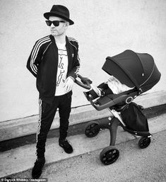 Fresh air: Sharing a photo of himself pushing Lydon's stroller, Deryck recently wrote: 'Ta. Deryck Whibley, Becoming A Father, Father Time, Celebrity Kids, Quality Time, Bad Boys, Baby Strollers, How To Become, Singer
