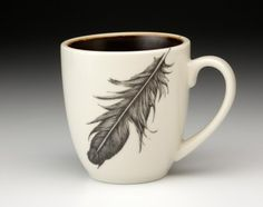 Gorgeous. (And so beautifully hand-drawn that it looks like you could pick it up.) :: Raven Feather Mug by Laura Zindel
