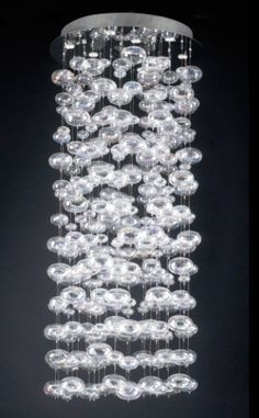 """PLC Lighting Bubbles Chandelier  Price: $1,431.00   Visit Store »  Uploaded by Becky Harris  We've been asked about where to find this fabulous chandy of cascading bubbles many times. It comes in a range of sizes so that you can have it cascade down from all sorts of places – over the dining table, in the middle of a winding staircase, or perhaps even your bedroom.     Polished chrome shade: rainbow clear glass   (10) 50W 120V GU10 base (bulb included)   Height: 60"""" Width / Diameter: 30"""""""