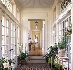 Loving this breezeway between the garage and the house!. So pretty!. #breezeway #corridor #garage  #windows #sunroom #housedesign #houseplants #house #homeliving #homedesign #coastalliving #homedecor #entryway #entrywaydecor