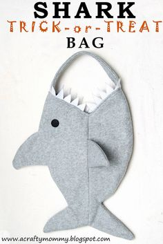 Tutorial: Shark bag with free pattern. I'm sure you could change the handle to a twisted cream one and adapt the shape a bit to create a Narwhal bag.