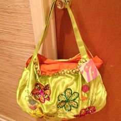"""Brand-new with tags! Bright lime green tote made of silk/satin w/sequin green, fuschia, & yellow flowers + bugle beads.Perfect bright accessory for spring! Blue, pink & orange raffia/straw creates flowers. Bag is orange inside with a zipper pocket & pouches for cell phone & keys.Makes a great gift! Bag is 12"""" high x 19"""" wide at widest point x 7"""" deep. Handle drop is 12"""". Thanks for looking! $45 http://poshmark.com/listing/4fa1a31543c13e7d5e02d20f"""