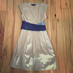 ⚡️final sale⚡️BCBGMAXAZRIA dress Tan colored dress with two shade of blue waistband. Worn twice. Looks great on body! Gives you a teeny waist! Side zip. Lined skirt. Cotton, nylon, spandex. Smooth fabric. BCBGMaxAzria Dresses Midi