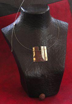 מהאתר -  http://www.amalthee-creations.com/jewells-70   oxidysed metal necklace patinated with gold leaf