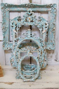 Blue ornate frame grouping hint of aqua with white accents distressed french chic wall decor Anita Spero. $540,00, via Etsy.