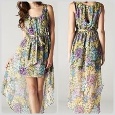 Pastel hi-lo floral Love Stitch dress NWT Pastel floral high-low dress by Love Stitch, purchased on HauteLook. NWT, never worn. Pastel purple, yellow, green, and blue floral with black lining. Comes with sash belt. Can be dressed up or down! MAKE ME AN OFFER! ✨ Love Stitch Dresses High Low