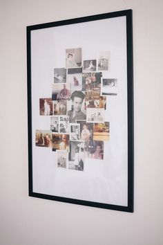 I really like this idea: Put a collage of old family photos in a large frame with plenty of white matting around the edges.