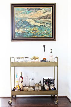 Bar cart + vintage painting.