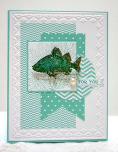 I used all Stampin' Up! supplies for this card: By The Tide and Itty Bitty Banners stamp sets with Whisper White and Coastal Cabana cardstocks and In Color paper. Fish embossed in gold on glossy white cardstock and colored with Olive and Coastal Cabana markers. Half Pearl to embellish. Edges embossed with Tulip Frame folder.