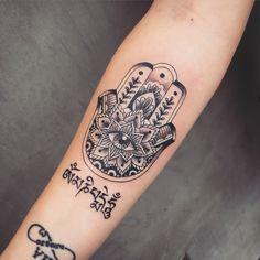 Hamsa tattoo by Andrea Revenant