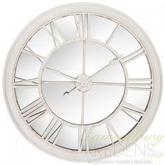 Duży zegar na którego tarczy znajduje się lustro to niebanalne rozwiązanie dla osób poszukujących ciekawych dodatków do domu.