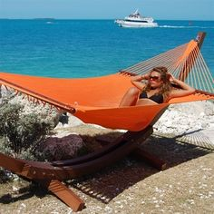 """Is Orange the new black? Well, you'll be nothing but """"in the pink"""" no matter what hammock you pick! FREE Ground Shipping on ALL hammocks and hammock chairs. Caribbean Jumbo Hammock (Orange), $179.95 (http://www.madeintheshadehammocks.com/caribbean-jumbo-hammock-orange/) #caribbeanhammocks #extralargehammockswithspreaderbars"""