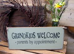 """This wooden sign is made from pine, and measures Approx 5.5""""W x 13""""L. It reads """"Grandkids Welcome Parents by Appointment"""". The front is painted sage green then distressed, the back is stained . We've"""