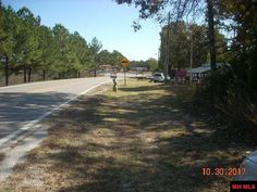 1.45 acres m/l on Hwy 5 just South of Norfork. Approximately 160 ft of frontage on the highway. 1.75 miles from river access. Close to Norfork schools, country store 1/4 mile away. No restrictions. This property is located in Norfork, Baxter County, Arkansas.