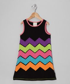 This stylish dress combines an easy-on silhouette with a neon zigzag design. Crafted with comfort and cuteness in mind, this slip-on piece is perfect for a day of play.62% polyester / 33% rayon / 5% spandexHand washMade in the USA
