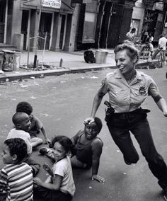 Fancy - Police Officer playing with children. New York ca. 1970.