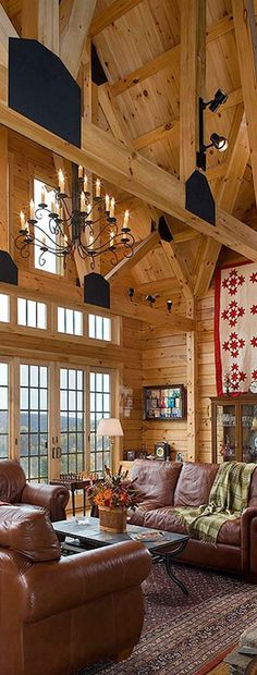 Coventry Log Homes.  Love the chandelier