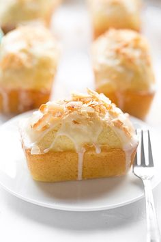 Mini Lemon Coconut Loaf Cakes: easy, soft, fluffy, loaf cakes full of lemon flavor and coconut flakes with a glossy, tangy glaze. Loaf Recipes, Lemon Recipes, Baking Recipes, Sweet Recipes, Dessert Recipes, Cupcakes, Cake Truffles, Cupcake Cakes, Poke Cakes