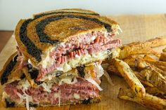 ♧The Reuben Sandwich (corned beef, sauerkraut, Russian dressing, and Swiss cheese on marbled rye), recipe (1) From: Poor Met