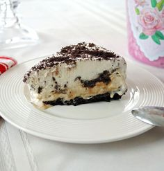 Vanilla-Caramel Ice Cream Cake with Oreo Crust - A family favorite with homemade caramel sauce & whipped cream!