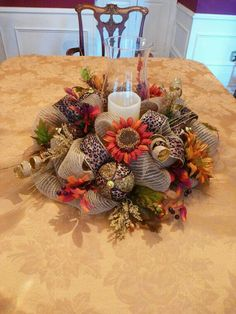 This 21 centerpiece will be a beautiful addition to your festive Thanksgiving table! It features leopard ribbon, beautiful fall sunflowers, gold and leopard balls and touches of burlap! **This listing does not include the candle or hurricane lamp** Thanksgiving Centerpieces, Thanksgiving Wreaths, Table Centerpieces, Thanksgiving Table, Centerpiece Decorations, Fall Decorations, Autumn Centerpieces, Fall Table, Deco Mesh Crafts