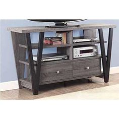 Coaster Furniture Trapezoid TV Console. Frame is solid wood with veneers. Gray finish. 2 Glass shelves and top. Maximum TV Size: 65 in. Cord management features.