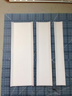 """Cut the following from card stock: 1 1/8"""" x 7 3/4"""", 1 7/8"""" x 7 3/4"""", 2 5/8"""" x 7 3/4"""" Score and fold 3/8"""" from each long side edge."""