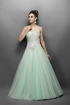 This Aqua green Indo western bridal gown has halter neck. This gown with intricate gold silver work in a fitted bodice and silver zircon work in paisley motif a