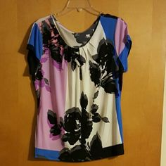 Woman's shirt Woman's shirt,  worn once. No holes or tears, comes from a smoke/pet free home. Tag says Petite XL Worthington Tops Blouses