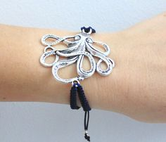 This is a beautiful big antique silver tone Octopus bracelet sitting on a double dark blue thread and has adjustable closure. Thread consists of two hand-knotted cords.  Br... #etsysocial #dailyetsysales