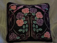 Black pillow with flowers