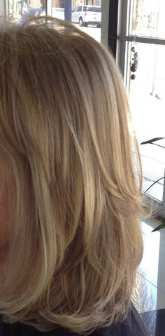 blonde highlights using @wellahairusa. I love the long layers of this haircut.