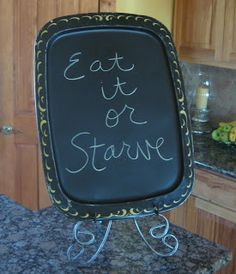 Turn an old TV tray into a chalkboard, ideal for leaving messages. (@ Ms Not So Perfect)