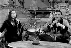The Addams Family Gomez and Morticia Addams Smoking Hookah- this is awesome ^-^ Addams Family Morticia, Los Addams, The Addams Family 1964, Morticia And Gomez Addams, Addams Family Tv Show, Gifs, Adam Meme, John Astin, Carolyn Jones