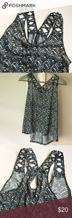"""Criss-Cross Strap Tank Leaf print tank with criss-cross straps. Racerback with keyhole detail. Scoop neck. Total length about 21"""" from top of shoulder to hem; in back the hem drops another 4"""" to about 25"""" long. Underarm to underarm about 17.5"""". Loose fit. Hem is about 25"""" wide. All measurements when laid flat. In excellent condition. H&M Tops Tank Tops"""