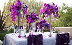 Tall Purple centerpieces. Gorgeous!